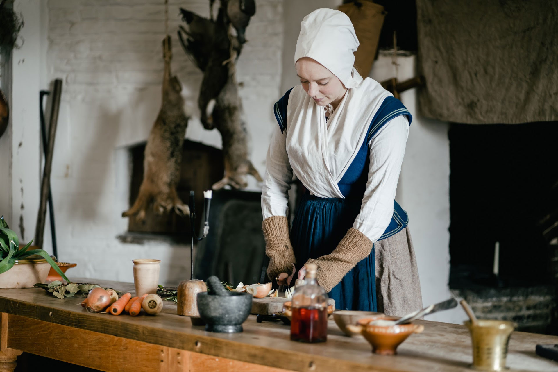 Llancaiach Fawr Manor servant in kitchen BANNER IMAGE 1920 pixels